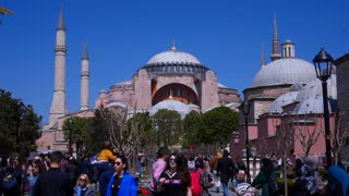 ISTANBUL, TURKEY - APRIL, 21, 2018: Tourists visiting the Hagia Sophia in Istanbul, Turkey