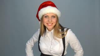 Joyful businesswoman in santa hat
