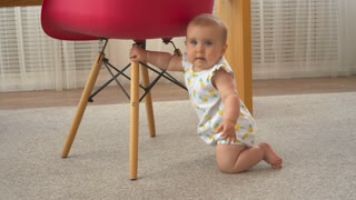 Little baby girl crawling at home