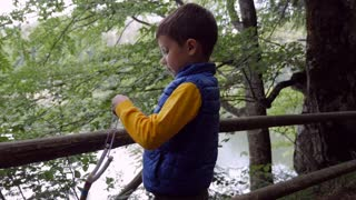 Little boy playing with sling toy