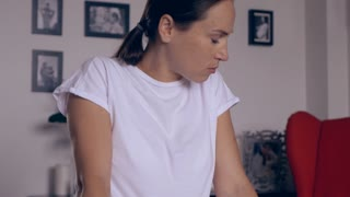 Loving pregnant woman doing prenatal exercises on fitball