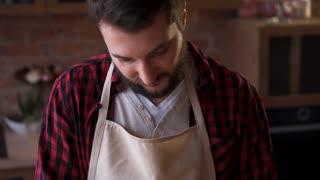 Man cutting fresh bread