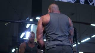 man trining chest in crossover machine