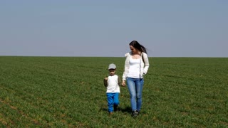 Mom and son spending time together in field