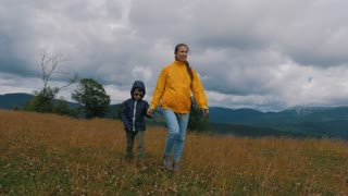 Mother and son travel in mountains