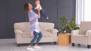 Mother dancing with baby