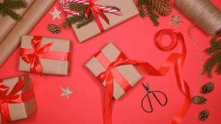 Person preparing Christmas present to friend