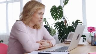 Positive female starts working on laptop
