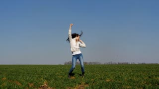 Positive woman jumping in field