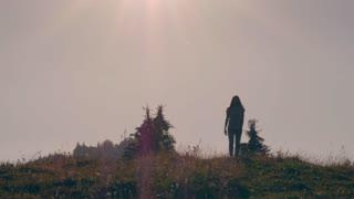 Pregnant female walking alone in meadow in Carpathian