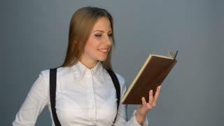 Pretty woman reading the book