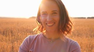 Romantic woman in wheat field enjoying landscape