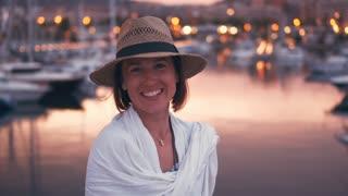 Romantic woman posing at camera during amazing sunset