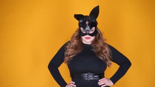 Seductive plus-size girl in bunny mask posing at camera