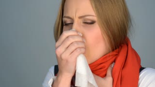 Sick and sad woman in red scarf