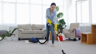 Slim woman cleaning carpet