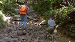 Son and mother on hiking trail