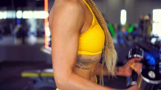 Sporty girl working out with dumbbells