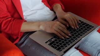 Tilt up of female working on the laptop