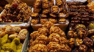 Traditional Turkish desserts with hazelnut, pistachio, almond in the market