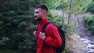 Traveler with backpack on a hike in forest