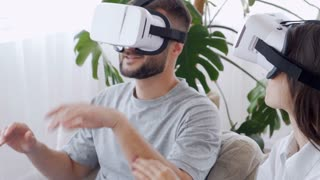 Two people wearing VR glasses
