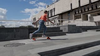 Urban youth riding skateboard outdoors, slow motion