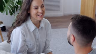Wife and husband talking and laughing at home