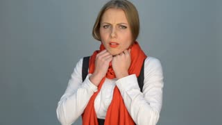 Woman coughing and looking at camera