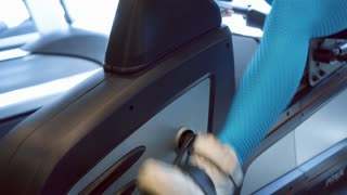 Woman cycling on exercise bike
