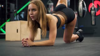 Woman doing back kick exercise