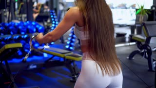Woman doing bicep cable curl