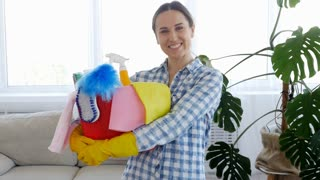 Woman embracing bucket with cleaning supplies