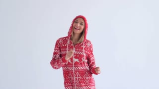 Woman in hood happily dancing