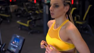 Woman training on treadmill