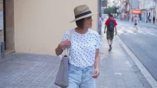 Woman traveler taking photos on phone while sightseeing