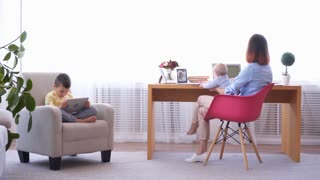 Woman trying to work from home with children