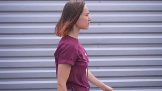 Woman wearing casual clothes walking in a hurry at street