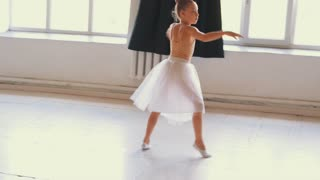 Young ballerina in tutu doing ballet pirouette