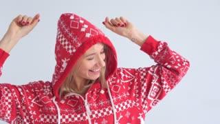 Young woman in hood having fun