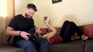 Amazing behind the scene of lifestyle photo session with a cute couple and cats. Flash is firing in the scene
