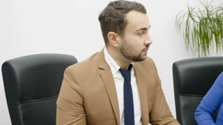 Businessman and businesswoman are arguing in an office
