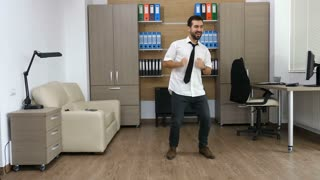 Businessman in his office is dancing after long hours of work. Funny adult CEO relaxing in after a full week of work