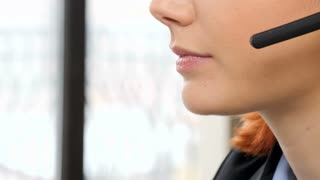 Close up of unrecognisable woman talking on the headphone
