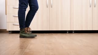 Close up traking shot of woman feets dancing on the kitchen floor