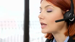 Customer support representative talking to people through the heandset