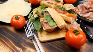 Delicious sandwiches on wooden board in the kitchen. Food and healthy