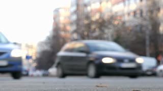 Intentionally blurred cars on the city streets driving
