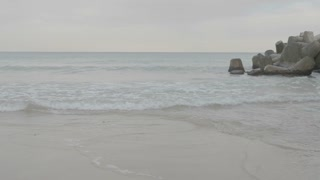 Sea waves splashing on the rocks