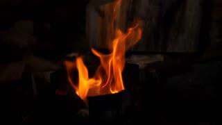 Slow motion of burning fire on black background
